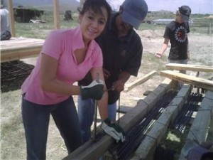 Eidi Cruz helping with a construction project