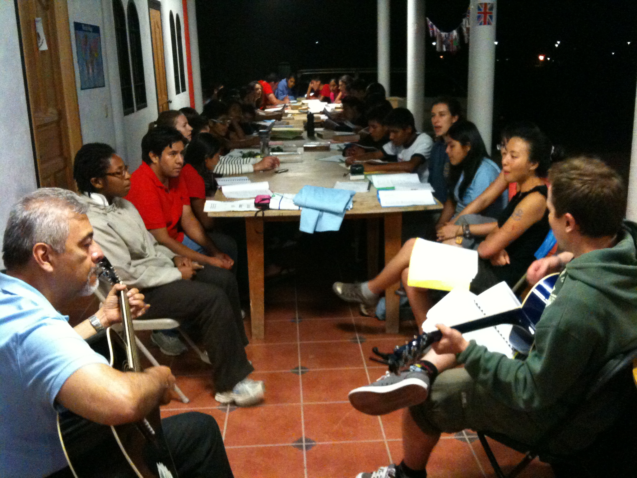 Saul and several volunteers participating in a bible study and discussion