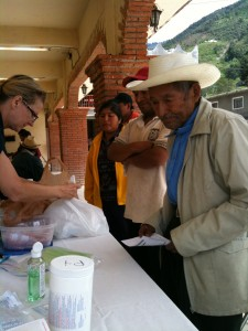 A gentleman receiving medication from international health clinic team