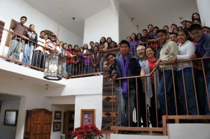 Students and Volunteers line the stairs and balcony of one of the student residences during Christmas celebrations