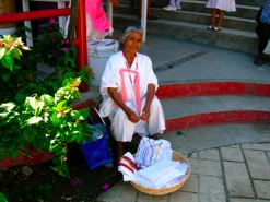 An older lady with a basket of cloth